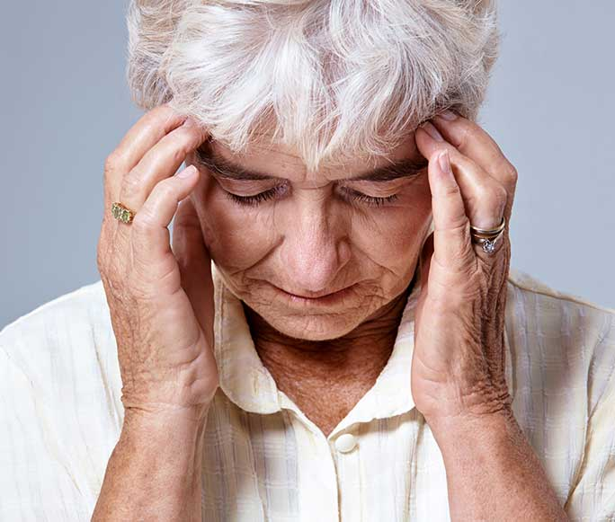 photo of woman with migraine